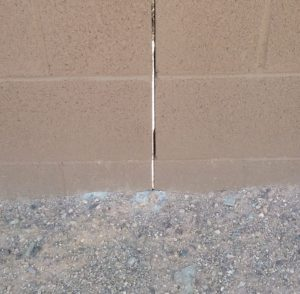 Gap in cinderblock wall